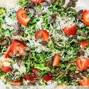 Kale Caesar Salad with Strawberries and Pumpkin Seeds