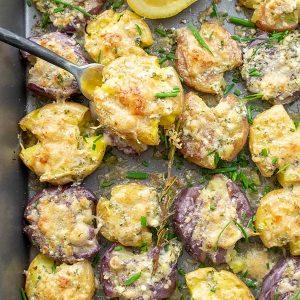 Smashed Crispy Potatoes with Garlic Herb Lemon Butter & Parmesan Cheese