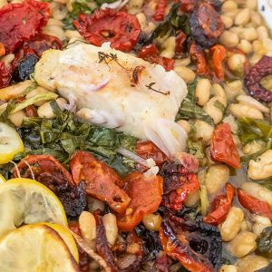 Roast Fish with Cannellini Beans Sundried Tomatoes and Greens
